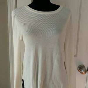 Cream sweater with black detailing in sleeves and
